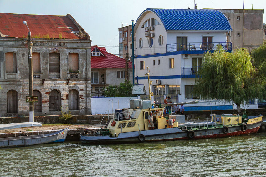 Danube Delta Danube Architecture Boat Building Exterior Built Structure Clear Sky Day Mode Of Transport Moored Nature Nautical Vessel Outdoors Real People Rippled Sky Transportation Tree Water Waterfront Waterway To Sulina