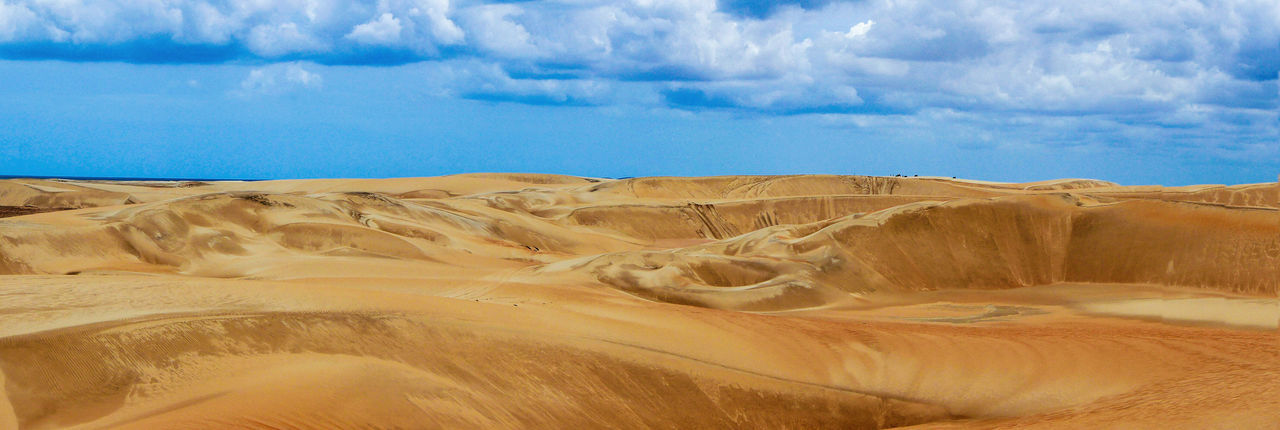 Beauty In Nature Cloud - Sky Day Desert Landscape Nature Outdoors Paradise Sand Sand Dune Sky