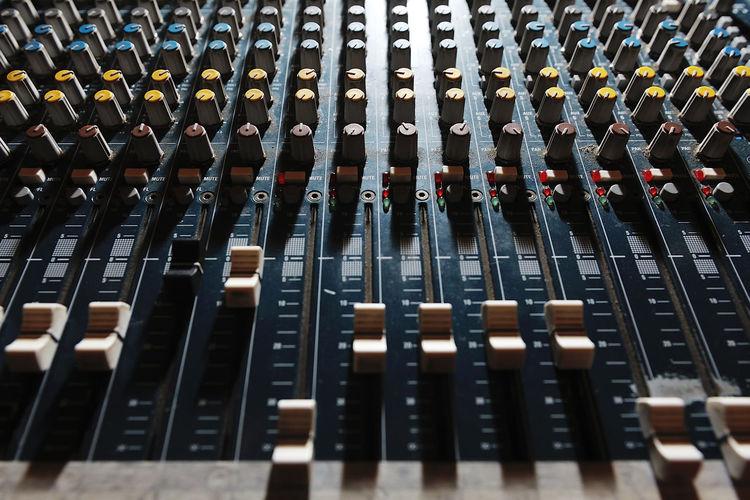 Full frame shot of sound mixer at studio