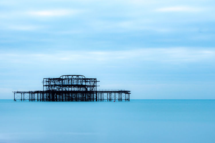 Ghost pier Night EyeEmNewHere Blue Water Water Aestethic Early Morning Beach Morning England Brighton Sea Blue Sky Architecture Built Structure Horizon Over Water Stilt House Tranquil Scene Tranquility Shore Scenics Foggy Countryside Idyllic Ocean