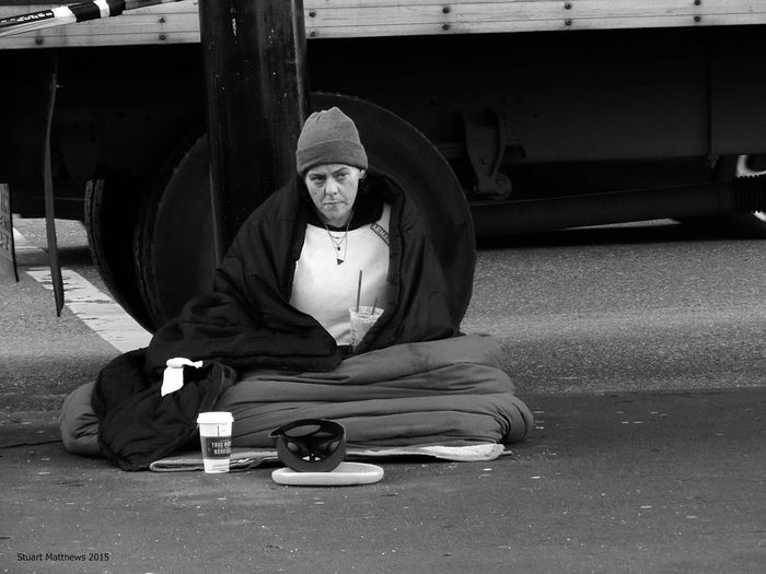 Homeless Woman Sitting On Road