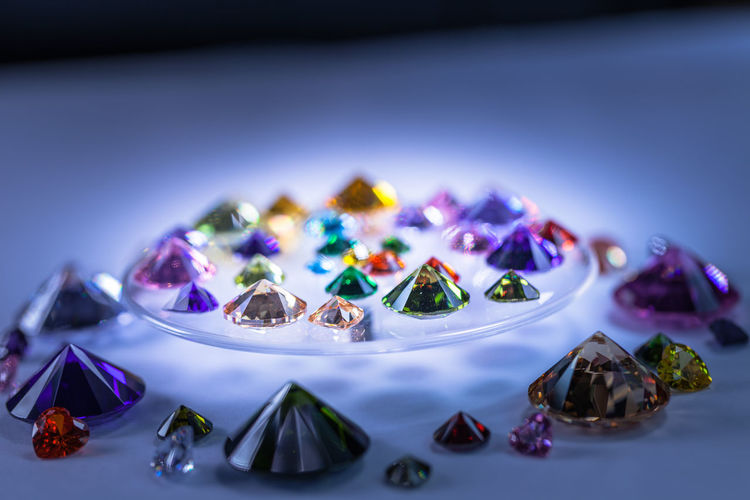 beautiful diamonds are turn around on the rotating diamond showcase. Blue Choice Close-up Collection Focus On Foreground Gemstone  Indoors  Jewelry Large Group Of Objects Luxury Multi Colored No People Personal Accessory Precious Gem Purple Selective Focus Semi-precious Gem Shiny Still Life Studio Shot Table Variation Wealth
