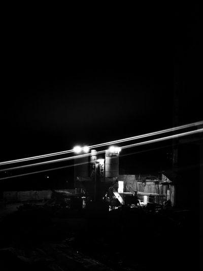 Illuminated train against clear sky at night