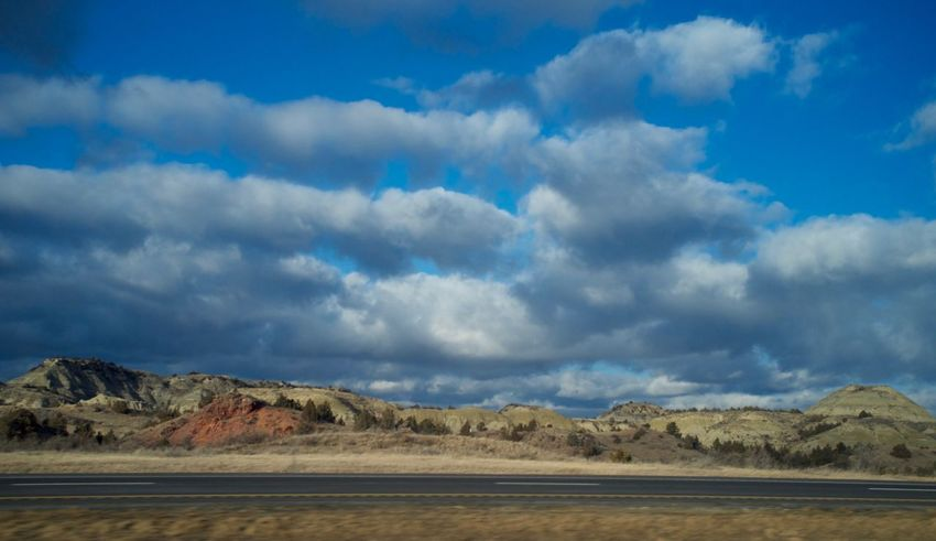 2-7-16 Arid Climate Beauty In Nature Cloud Cloud - Sky Cloudscape Cloudy Dramatic Sky Dusk Geology Horizontal Symmetry MidWest No People North Dakota Outdoors Overcast Physical Geography Remote Scenics Sky Sunset Symmetry Tranquil Scene Tranquility Trip Western North Dakota