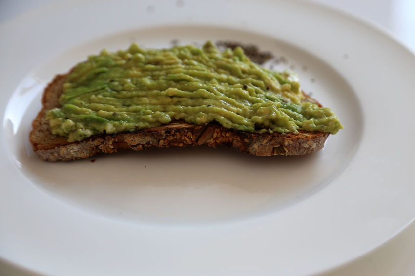 toasted bread with avocado creme on white plate Close-up Day Food Food And Drink Freshness Healthy Eating Indoors  No People Plate Ready-to-eat Guacamole Garlic Clove Avocado Toasted Bread Avocados Sandwich Breakfast Vitality Green Color High Angle View Indoors  Cream Pita Bread Bread Healthy Lifestyle