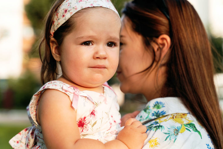 Portrait of cute mother with baby girl