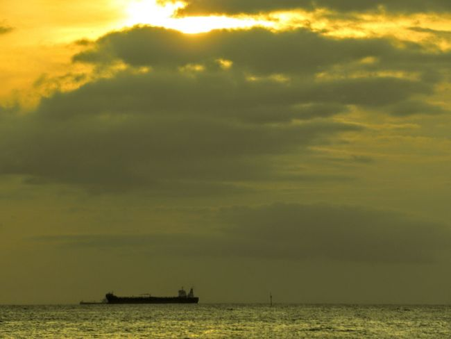 Nautical Vessel Oil Ship Awaiting Afternoon Gold Colored Sea
