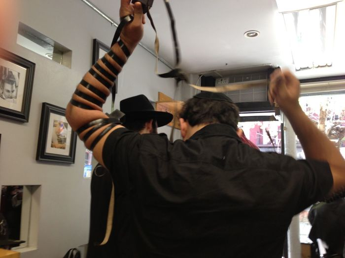Daven Men Praying Tefillin Barber Shop East Village Nyc Hassidic Jews Indoors  Men Shabbat Sabbath Shabbos