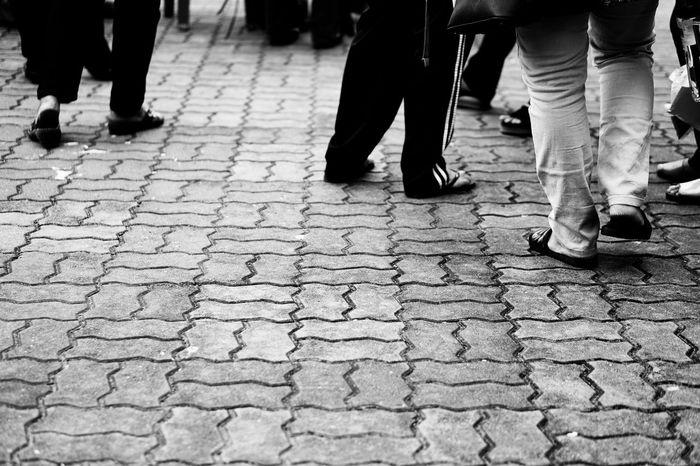 Streetphotography Blackandwhite Low Section Body Part Human Body Part Human Leg Group Of People Street City Walking Human Limb Limb People Real People Shoe Footpath Day Adult Cobblestone Lifestyles Stone