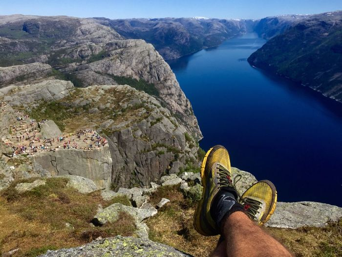 Enjoying the view of the Preikestolen and Lysefjord in Norway 😍 Fjord Water Nature One Person Personal Perspective Exploration Mountain Day Shoe Landscape Cliff Human Leg Adventure Beauty In Nature View Live For The Story The Great Outdoors - 2017 EyeEm Awards The Great Outdoors - 2017 EyeEm Awards Place Of Heart Out Of The Box Lost In The Landscape