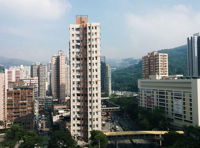Residential Buildings By Street Against Sky