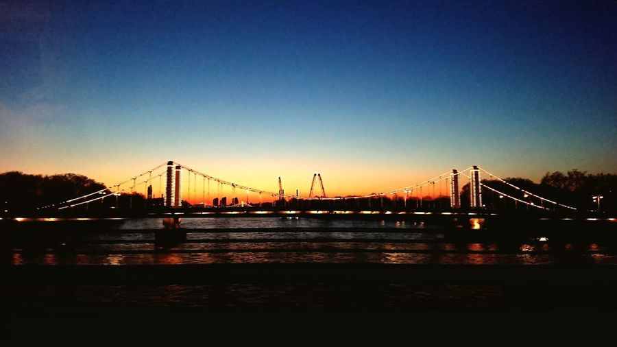 View from a train Blurred Motion City Water Cityscape Sunset Suspension Bridge Bridge - Man Made Structure City Life Sky Architecture Built Structure