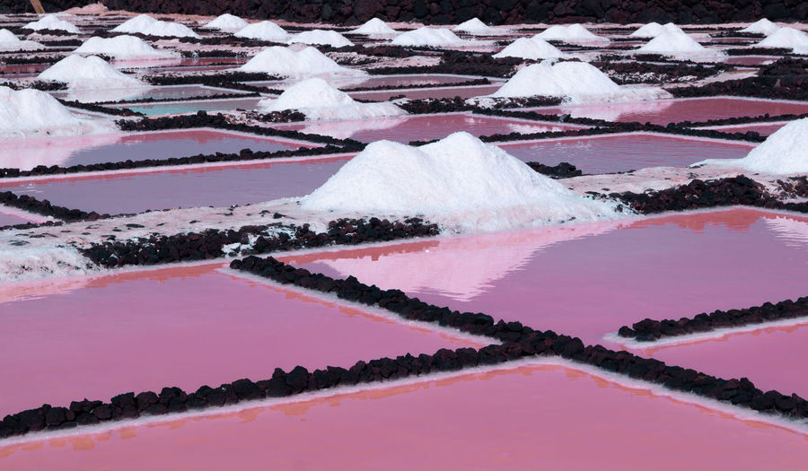 Salt flats farms showing red pink water in la palma canary island