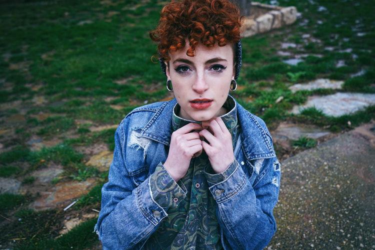 Portrait of female punk on field