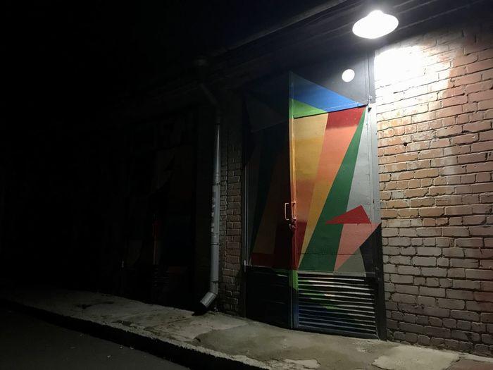 Multi colored wall in illuminated building