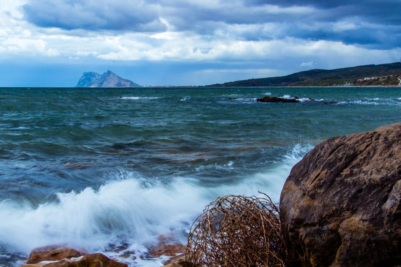 A view of the Rock of Gibraltar taken from Alcaidesa beach Cloudy Day Cloudy Sky Gibraltar Rock Gibraltar Views Landscape_Collection Beach Beauty In Nature Cloud - Sky Cloudy Sky And Sea Gibraltar Gibraltarview Land Motion Power In Nature Rock Rock - Object Rock Formation Scenics - Nature Sea Sea View Sea Views Sky Stormy Day Water Waves Crashing