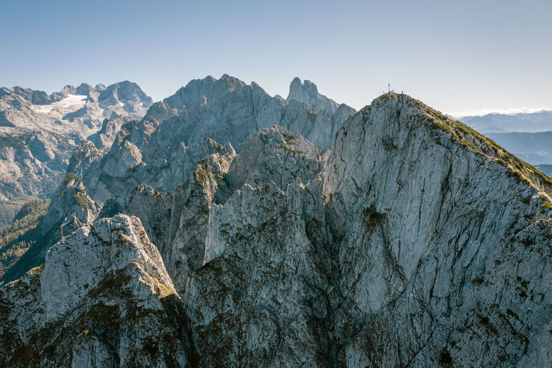 Aerial image of a group of climbers on top of mountain peak, gosaukamm, austria.