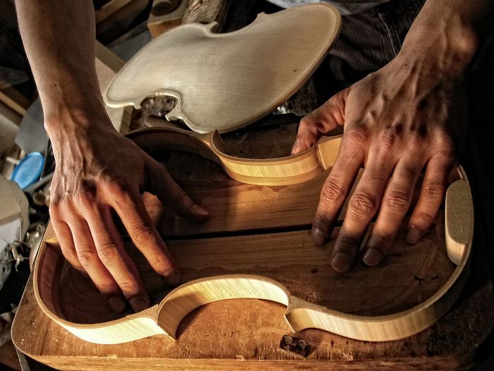 Adult Close-up Craftsperson Day Expertise Guitar Human Body Part Human Hand Indoors  Instrument Maker Men Music Musical Instrument Musical Instrument String Occupation One Person People Real People Skill  Violin Wood - Material Work Tool Working Workshop