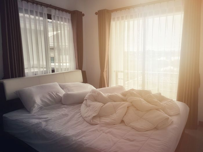 Absence Bed Bedroom Comfortable Curtain Day Domestic Room Electric Lamp Furniture Home Home Interior Home Showcase Interior House Indoors  No People Pillow Sheet Sunlight Textile Window