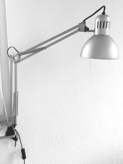 Close-up of electric lamp hanging on cable
