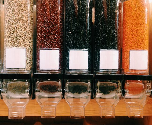 Various Lentils In Containers At Store