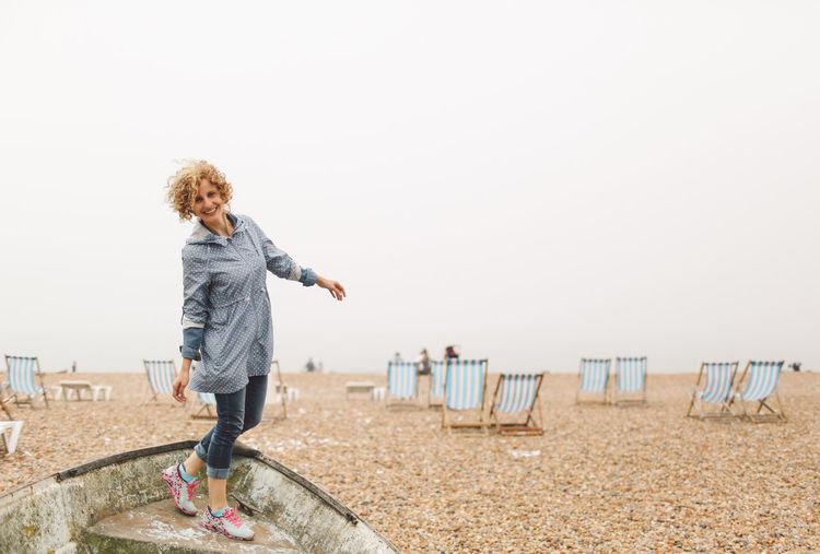 Beach Beauty In Nature Blonde Brighton Brighton Pier Casual Clothing Curly Hair Day Foggy Full Length Girl Leisure Activity Lifestyles Nature Outdoors Scenics Sea Shore Sky Standing Summer Tranquil Scene Tranquility Vacations People And Places