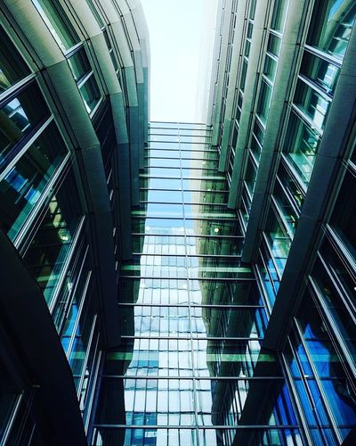 Architecture Built Structure Low Angle View Building Exterior Highrise Skyscraper Office Building Reflection Glass - Material City Tall - High Tall Building Story Tower Sky Glass Repetition Development Outdoors Architectural Feature