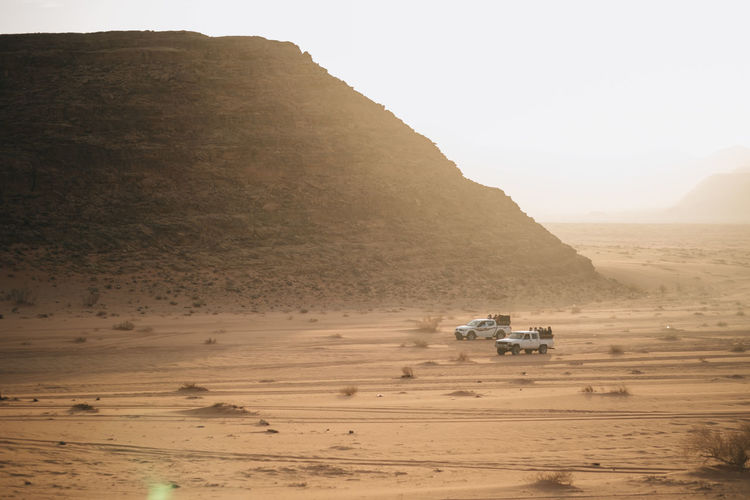 Jeeps in the desert against mountain