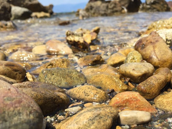 Beach Pebble Shore Pebble Beach Water Nature Surface Level Rock - Object No People Sea Outdoors Beauty In Nature Close-up Day EyeEmNewHere
