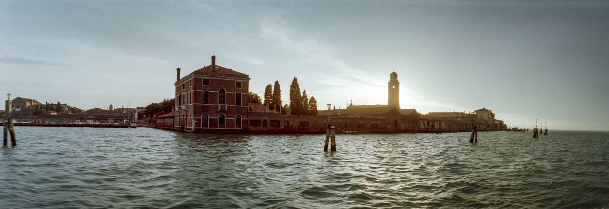An atmospheric view out of a boat-taxi in Venice. Venice, Italy Venice Water Architecture Travel Destinations Sunset Canal Analogue Photography Panorama Panoramic Photography Panoramic Landscape