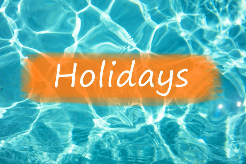 """Detail of word """"Holidays"""" on swimming pool water and sun reflecting on the surface. Freshness Fun Holiday Holidays Postcard Reflection Summertime Swimming Text Background Backgrounds Enjoyment Fresh Leisure Activity Relax Relaxation Summer Swimming Pool Wallpaper Water"""