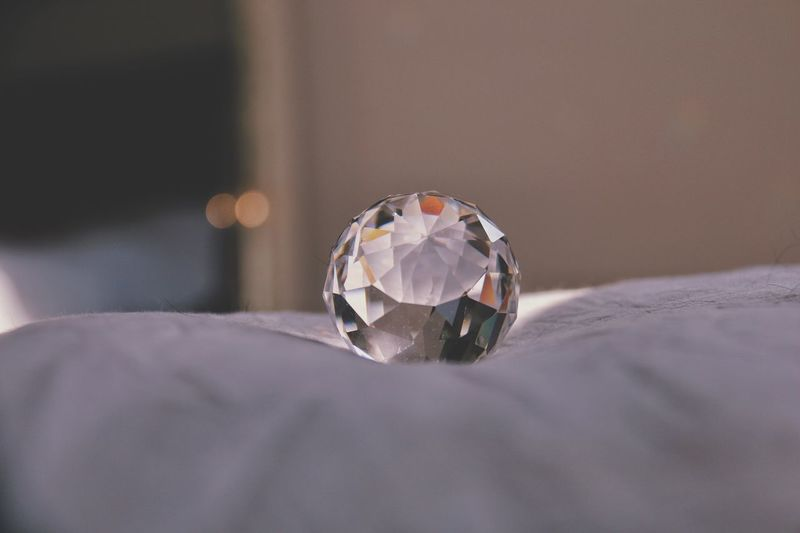 Close-up of diamond on bed at home
