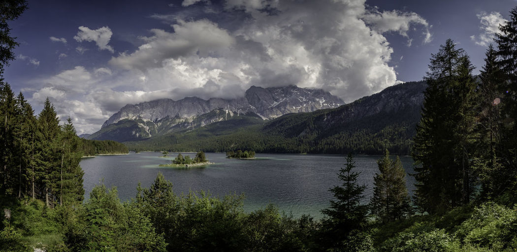 Eibsee Environment Exploration Forest Growth High Lake Landscape Mountain Mountain Peak Mountain Range Nature No People Outdoors Plant Range Scenery Sky Travel Tree Water