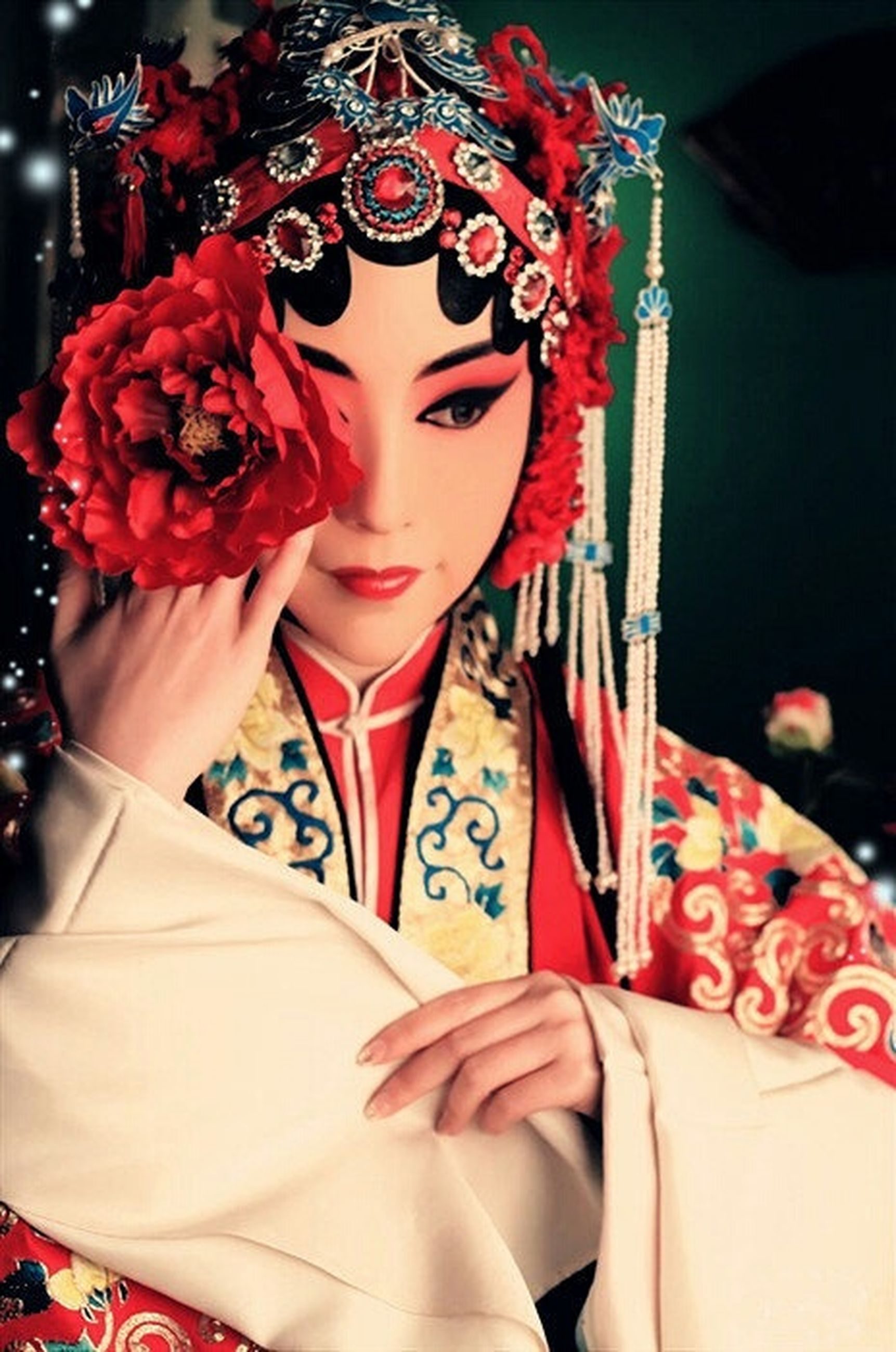 indoors, tradition, lifestyles, red, celebration, person, leisure activity, cultures, holding, art, creativity, fashion, art and craft, religion, close-up, decoration, front view