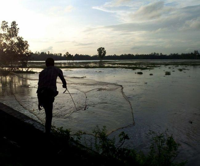 Centerpiece Angling Centerpiece Fishhunter Seasonal Flooding In Bangladesh Evening Cloudssky Ruralman Rurallife  Beautifulbangladeah EyeEm Nature Lover
