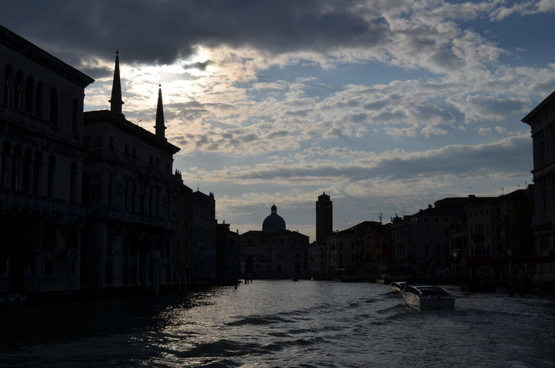 Scenic view of canal grande amidst buildings in city