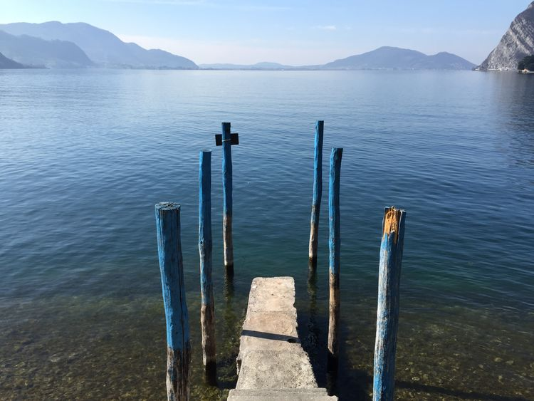 Beauty In Nature Idyllic Jetty Lake Mountain Mountain Range Nature Outdoors Pier Pier Railing Rippled River Scenics Sea Sky Tranquil Scene Tranquility Water Wood - Material Wooden Post