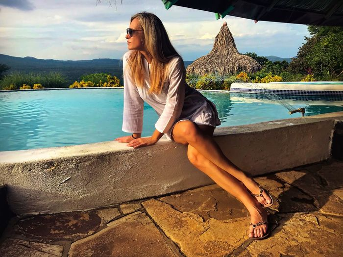 Jungle One Person Water Leisure Activity Real People Lifestyles Sitting Casual Clothing Young Women Nature Lake Relaxation Outdoors Mountain Growth Nicaragua Eco Lodge Beautiful Woman Tranquility Scenics Swimming Pool
