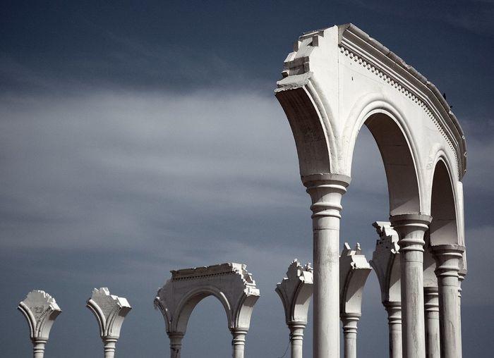 Exterior of historic columns against sky