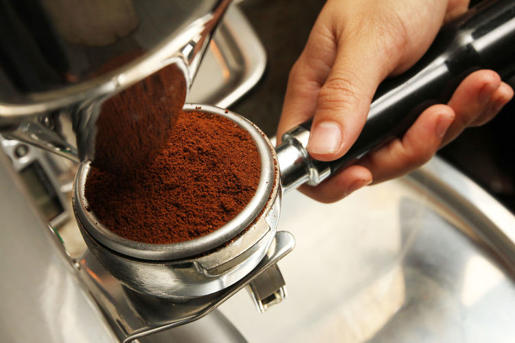 Cropped Image Of Hand Holding Ground Coffee