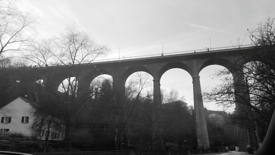 Under The Bridge Luxembourg From A Moving Vehicle Urban Geometry Nature Vs City Architecture Blackandwhite Photography Bridge - Man Made Structure