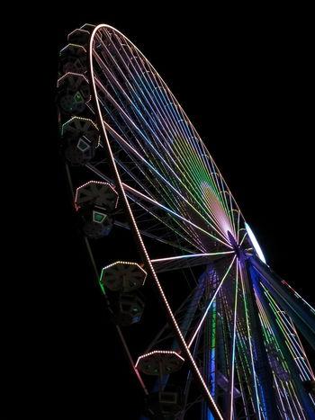 ferris wheel by night Amusement Park Black Background Coulourful Fairground Ride Fairground@night Ferris Wheel Illuminated Motion Night Outdoors Sky