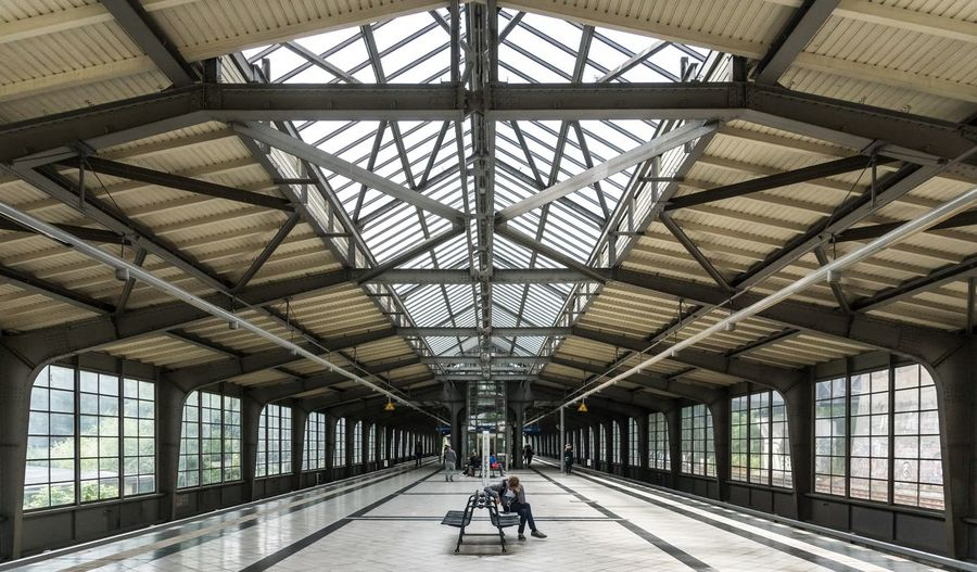 Architecture Built Structure Casual Clothing City Life City Life Diminishing Perspective Gleise Leisure Activity Lifestyles Person S-bahn S-bahnhof Sbahnhof Schienen Seating Bench Sitzbank Street Photography Symmetry The Way Forward