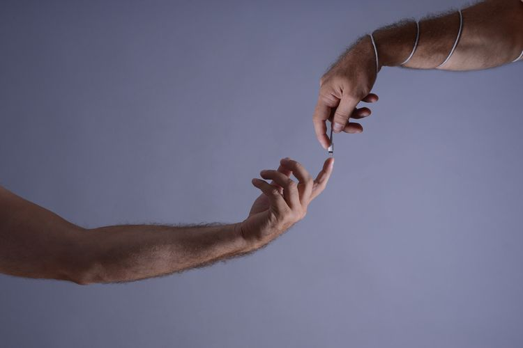 Close-up of hand holding blue wall