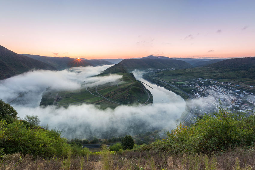 I woke up at 4am and drove 200km to experience this awesome moment at the Moselschleife in Germany. Beauty In Nature Bremm Cloud - Sky Day Fog Hiking Landscape Landscape_Collection Morning Mosel Moselschleife Mountain Nature No People Outdoors River Sky Sunrise Sunset Travel Tree Tree Area Water