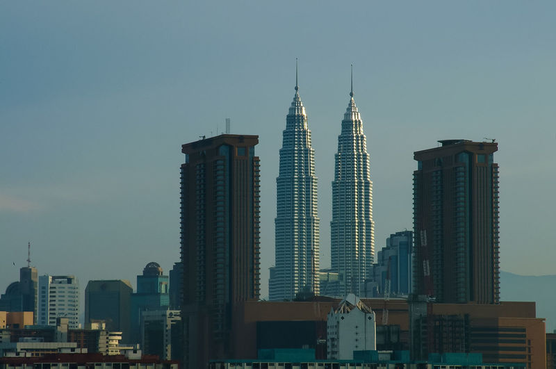 Petronas towers against sky in city