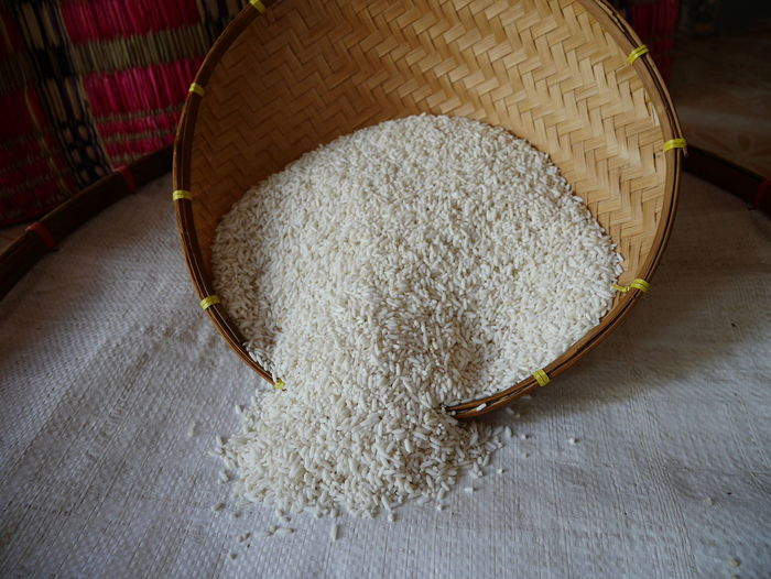 Pour the rice Agriculture Asian  Pouring Rice Seeds Thailand Bamboo Close-up Day Fawooden Surface Food Food And Drink Freshness Grain Rice Healthy Eating High Angle View Indoors  Nature No People Organic Food Raw Food Rice Seeds Streaming White Color White Rice