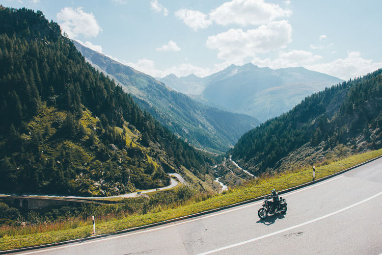 Alps Day Horizontal Motorcycle Mounatins Mountain Mountain Range Mountain Road Nature Outdoors Road Sky Swiss Alps Swiss Mountains The Great Outdoors - 2017 EyeEm Awards Transportation Valley
