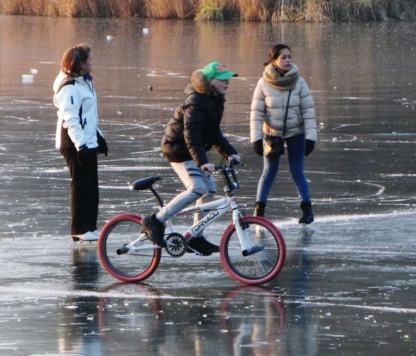 Fun On The Ice Frozen Lake Bicycle Outdoors Cycling On Ice Wintertime Ice Sports Ice Skating Sunshine Reflections