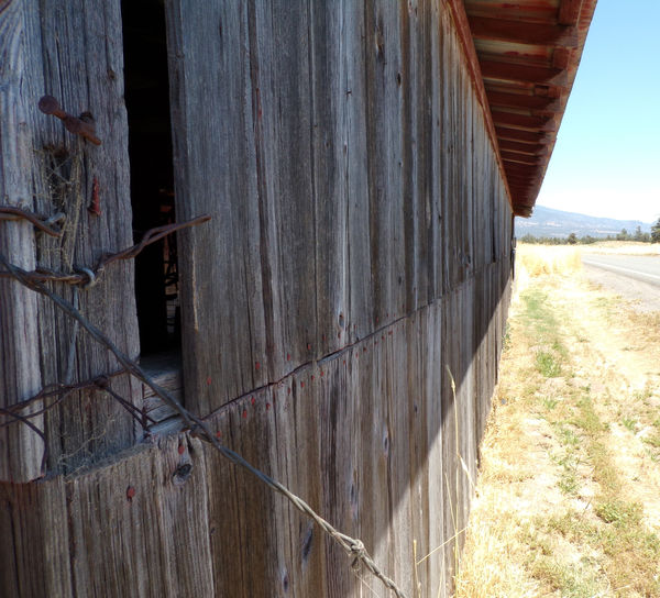 barn side Barn Country Road Isolated Mowed Grass Rustic Rustic Barn Countryside Grey Wire Fence Close Up,